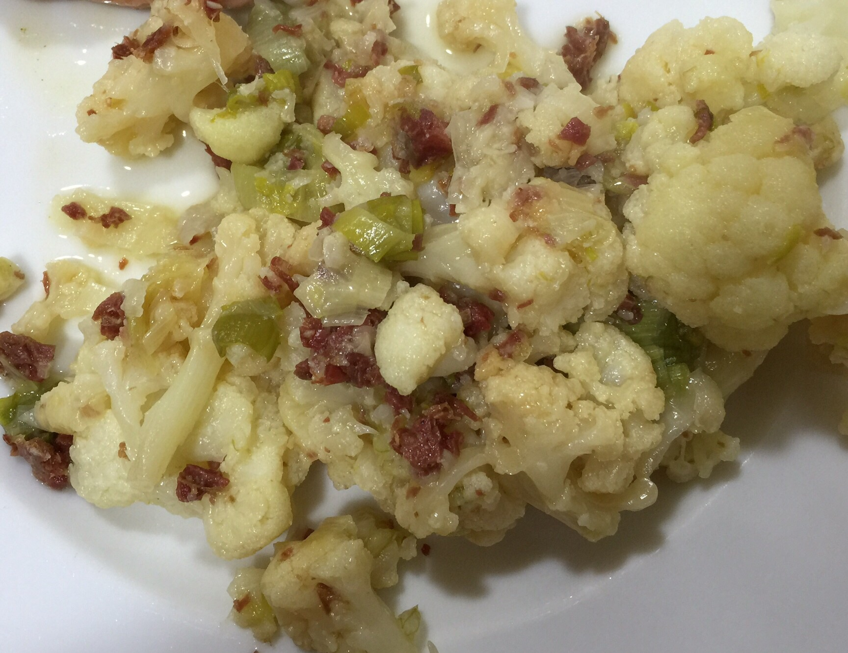 Coliflor al tombet con virutas de ibérico y cebolla tierna con Thermomix®